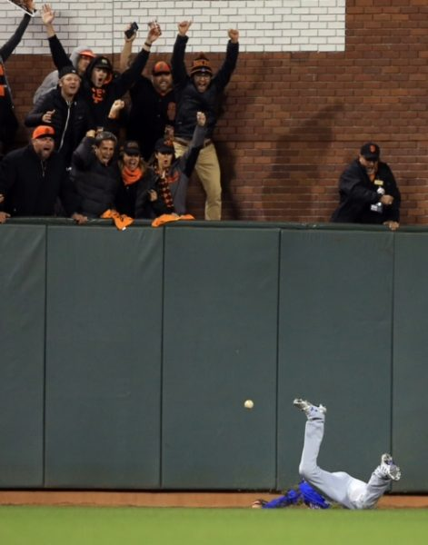 Chicago's Albert Almora Jr. fails to catch a triple by Conor Gillaspie which scored two runs in the eighth inning of Game 3 during the NLDS at AT&T Park in San Francisco, Monday, Oct. 10, 2016.