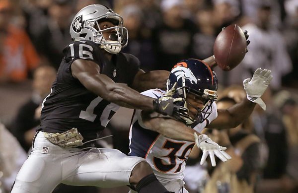 Tauren Nixon of the Broncos interferes with Johnny Holton on a series of plays where Denver was called for three pass interference calls that led to an Oakland TD, Sunday Nov. 6, 2016 in Oakland.