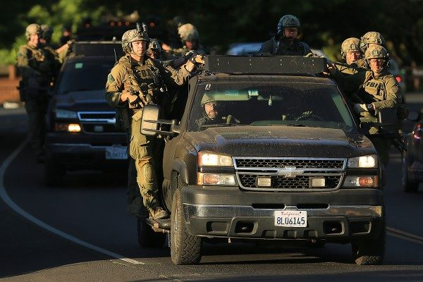 The FBI rolls back to the Calistoga command post after a second suspect was taken in to custody, involving the Windsor armored car robbery, Tuesday July 12, 2016. (Kent Porter / Press Democrat) 2016