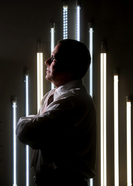 Teslights Sales Director Marc Kelley with LED tubes, Wednesday March 2, 2016. Teslights a year-old Santa Rosa LED lighting company has a manufacturing plant in China and has recently received approval for a PG&E rebate program for business customers.(Kent Porter / Press Democrat) 2016