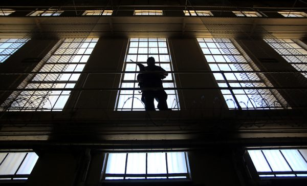 A guard with rifle, watches over San Quentin's Death Row, Tuesday August 16, 2016. (Kent Porter / The Press Democrat) 2016