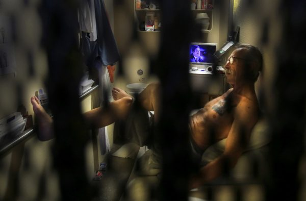 Serving on death row at San Quentin State Prison, Tuesday August 16, 2016, Michael Schultz passes the day by reading in his cell. According to newspaper reports, Schultz raped and strangled Cynthia Burger, 44, in 1993 in her Port Hueneme, Ca. condo. Schultz was convicted in 2003 for her murder. (Kent Porter / The Press Democrat) 2016