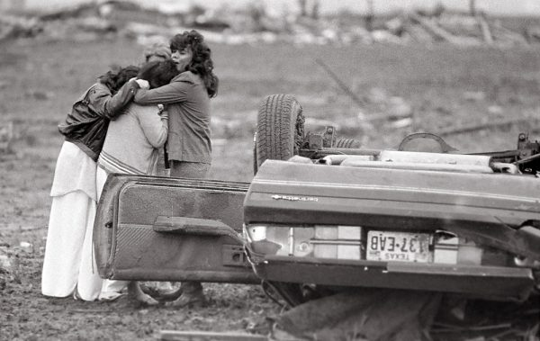 The morning after the tornado, families began to find their loved ones as the walked the path of the tornado. 121 people were injured. (©Kent Porter)