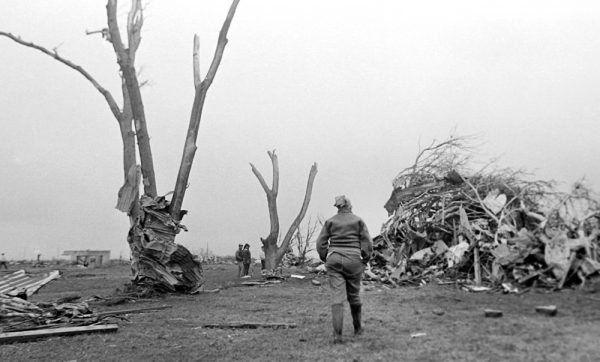 Peggy Walker looks at the damage May 23, 1987, the morning after Saragosa, Texas was hit by an EF4 tornado, killing 30 people. (© Kent Porter)