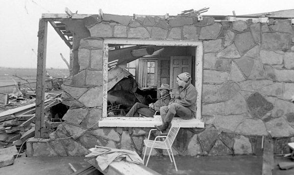 Peggy and Bob Walker sit in stunned silence May 23, 1987, the morning after Saragosa, Texas was hit by an EF4 tornado, killing 30 people. (© Kent Porter)