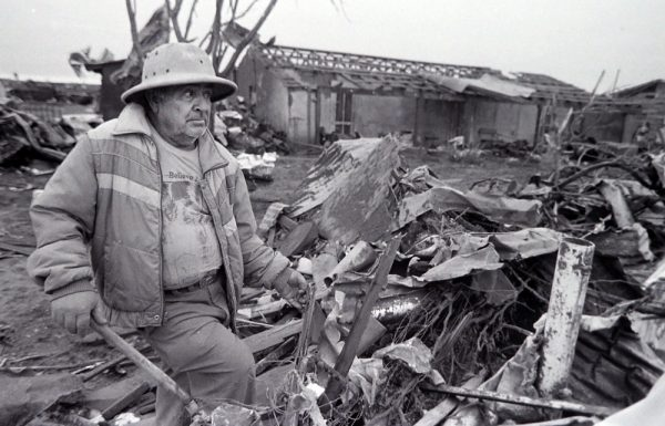 A resident of Saragosa looks over the damage caused by the tornado the May 23, 1987. (© Kent Porter)