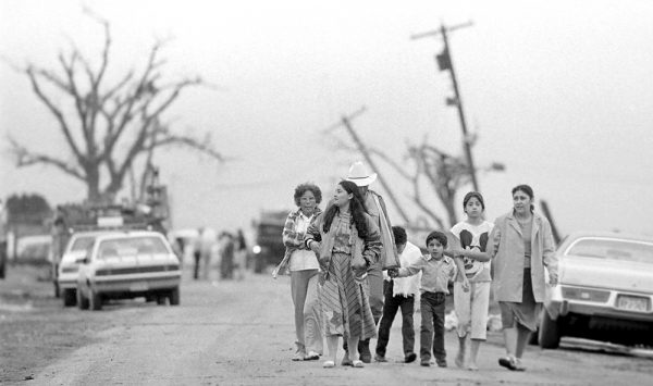 A Saragosa family takes a trek to view tornado damage on County Ranch Road 1215. (©Kent Porter)